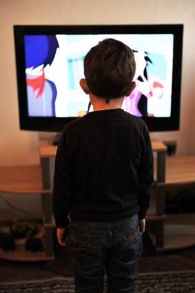 kid watching tv